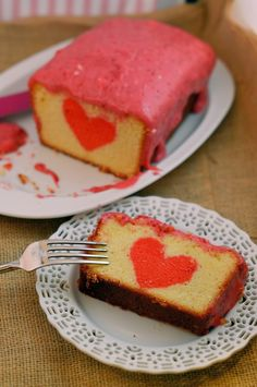 Peek-a-Boo Pound Cake with Raspberry Cream Cheese Frosting- decadent pound cake with a surprise inside! Bonus: it tastes as good as it looks! #poundcake #valentinesday www.savoryexperiments.com