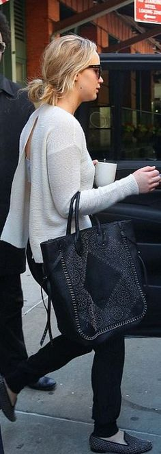 Jennifer Lawrence: Sweater = Stella McCartney  Shoes – Louis  Purse – Coach  Sunglasses – Tom Ford