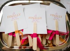 Since it's going to be a summer wedding, having fans as the programs could be perfect, and they're so simple and cute with the ribbons.
