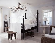Love this room - striped floor, chandelier, bed, stool - yep, everything