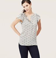 Acorn Dot Petal Sleeve Blouse - Delicate petal sleeves enhance this easygoing beauty, adorned with an adorable acorn print. Split neck. Short petal sleeves. Covered henley placket. Shirttail hem with side slits.