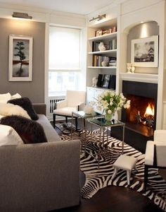 Clean lines, animal print rug and fireplace make the room more inviting.