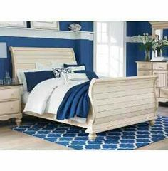 A simple white sleigh bed.