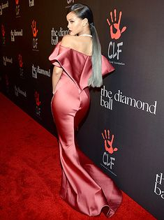 Rihanna shows a back view of her Zac Posen gown.