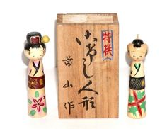 """They are from the early 1970's, and they measure a tad over 3"""" high. The female kokeshi doll's kimono has a beautiful red and pink flower and green leaves, while the male's kimono has a green and red plaid design. 