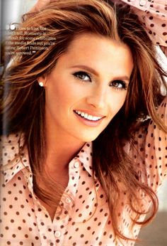 Loving the hair color and her make up.Stana Katic.