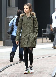 Bundled up: Lily Collins stepped out in a large coat and black tights as she headed out for Christmas shopping at The Grove in Los Angeles on Friday