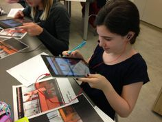 A student uses the iPad to scan an image that brings an informational video to…