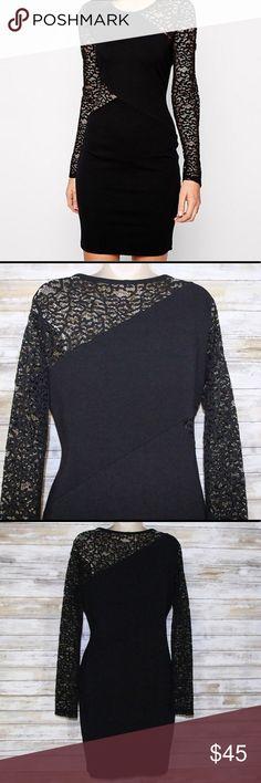 Like New BCBG black jorden bodycon dress sz L BCBG black dress with lace sleeves and lace detail around mid area  Like New Condition  sz L  65% rayon 30% nylon 5% spandex   waist to hem 20.5 inches BCBGMaxAzria Dresses