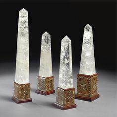 A set of seven rock crystal obelisks on moorish mosaic and pietra dura bases height of taller 27 1/2 in.; width 5 1/4 in.; depth 5 1/4 in.; height of smaller 18 3/4 in.; width 4 1/2 in.; depth 4 1/2 in. 70 cm; 13.5 cm; 13/5 cm; 47.5 cm; 11.5 cm; 11.5 cm