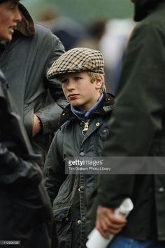 Peter Phillips, wearing a waxed jacket and tweed cap, at the Royal Windsor Horse Show, held at Home Park in Windsor, Berkshire, England, Great Britain, 23 May 1987. Peter is the son of Princess Anne and her first husband, Captain Mark Phillips; they divorced in 1992.