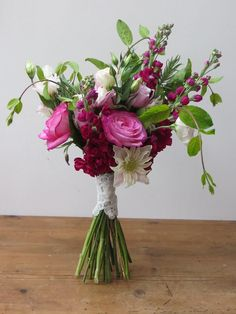 Pink bouquet of roses, stocks, clematis and honeysuckle by Apple Blossom Flowers