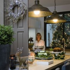 The whole look, the tree decorated outside the Kitchen window, love it!  How the French like Christmas - Sharon Santoni