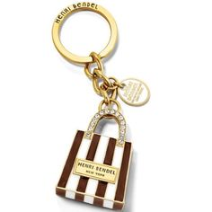 "❄️Jonas Sale❄️Henri Bendel Bag Key Chain The Henri Bendel Shopping Bag Keyfob keeps your last trip to 5th Avenue close to home no matter where you are.  • Brass and gold plating  • Dimensions: 4.25""H x 1.25""W henri bendel Accessories Key & Card Holders"