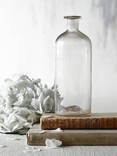 Glass bottle+ antique books = wow
