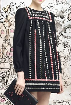 Red Valentino. I seriously want this adorable little dress!!