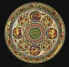 A DIAMOND-SET AND ENAMELLED GOLD GOBLET, DISH AND SPOON, JAIPUR, CIRCA 1900 the set comprising a diamond-set and enamelled gold goblet with cover, fitted on a dish with polychrome enamel decoration featuring roundels containing animals hunting or floral bouquets with birds, within a vegetal background featuring various animals, with a floral border, the spoon set with colourful gemstones and enamelled on reverse with en-suite design