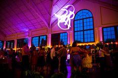 Raspberry Plains in Leesburg, VA with a monogram and fuchsia uplighting.