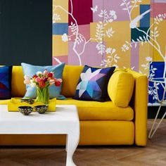 Ideas for Living Rooms.  She's crafty. House & Garden's decoration editor Gabby Deeming was inspired by the Matisse exhibition at the Tate Modern to get crafty with cut-out paper wallcoverings from de Gournay and patchwork textiles. The bright yellow sofa ('Hackney', £2,577, from Wrong for Hay) pairs beautifully with the bright colours, but would look equally gorgeous with grey, charcoal, deep indigo or black. Taken from the May 2014 issue of House & Garden. Styling: Gabby Deeming.