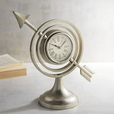 Pier 1 Imports Armillary Desk Clock ($20) ❤ liked on Polyvore featuring home, home decor, clocks, silver, pier 1 imports, star clock and star home decor