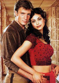 Firefly, 2002: Capt. Mal Reynolds (Nathan Fillion) and Inara Serra (Morena Baccarin)