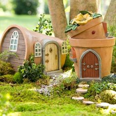 Oh, my we love these fairy houses that light up at night when the fairies come home! Miniature Fairy Garden Solar Flower Pot Home - DIY Fairy Gardens Fairy Garden Houses, Diy Garden, Garden Crafts, Garden Projects, Garden Art, Gnome Garden, Fairy Gardening, Fairies Garden, Fairy Garden Doors