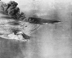Sandy Beach stretching along southeastern edge of tip of Iwo Jima at right of Mt. Suribachi, volcano at lower left, is scene of landing of U.S. Marines on Iwo Jima.
