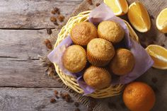 Citrus muffins and fresh oranges close-up. horizontal top view
