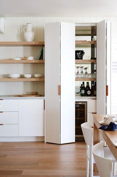 Joinery in a nook means no wasted space. Create a pantry or a wine bar, like this one by Bloom Interior Design & Decoration, behind doors