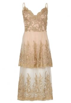 Strappy gold heavily embroidered border tuile bridesmaid dress. Mid calf length. Strappy scalloped neckline. Colour matched strappy stretchy sculpting slip.