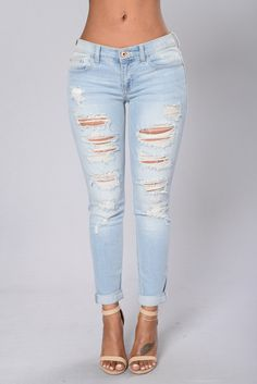 - Available in Light - Distressed Ripped Front - Cuffed Bottom - Low Rise - 75% Cotton 24% Polyester 1% Spandex