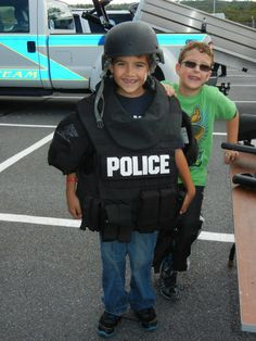 Young guests to Heroes Day suit up for action in the gear used by the Lackawanna County SWAT team.