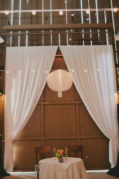 White Shear curtains up on the barn wall behind where the bride and groom will sit would look beautiful!!  Great Idea for Brides!  Red Tin Barn - Cindy 678-378-8484 Barn Wedding Decorations from rusticweddingchic.com