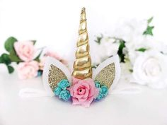 Our beautiful unicorn headband is the perfect accessory for any magical unicorn! Made from a metallic gold horn and beautiful fabric flowers and securely set onto a sugar glitter white headband. Or you can choose to have it made as a hair clip, using an alligator clip with silicone