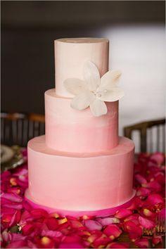 pink ombre tiered wedding cake #weddingcake #ombrecake #weddingchicks http://www.weddingchicks.com/2014/02/24/ruffles-and-roses-wedding-inspiration/