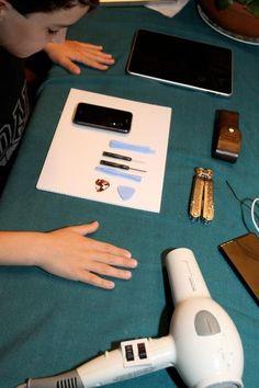 Boy fixes cracked iPhone screen for $21.95 (photos)