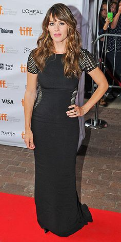 Toronto Film Festival | JENNIFER GARNER | Bombshell alert! For the premiere of Men, Women & Children, Jennifer picks a body-con Stella McCartney design with mesh sleeves and insets at the obliques.
