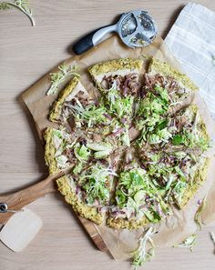 cauliflower & brussels sprout crust pizza with a white bean spread, caramelized onions & shredded sprouts - whats cooking good looking?