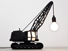 Studio Job - a lamp cast from solid bronze in the form of a wrecking ball hung from a crane.