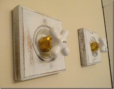 old faucet knobs on wood rosettes for towel hooks. kkreations 001