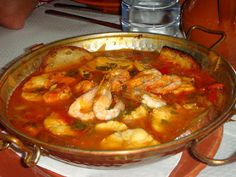 Cataplana cooking Portuguese style. This is one of the best dishes you can eve try. Regional portuguese cuisine is very rich, and this is one of the best examples!