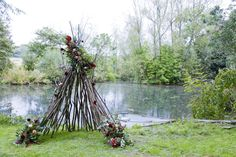 "Quirky teepee flower decor by Pink Peony. For more Alternative Wedding inspiration, check out the No Ordinary Wedding article ""20 Quirky Alternatives to the Traditional Wedding""  http://www.noordinarywedding.com/inspiration/20-quirky-alternatives-traditional-wedding-part-2"