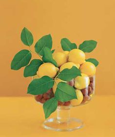 Pair smooth objects (lemons) with smaller, textured ones (nuts) for a compelling composition. Show it off in a glass bowl with a pedestal for drama.