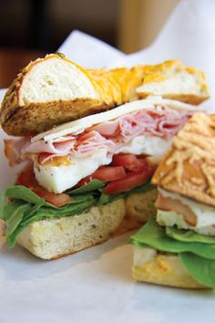 """Old School Bagel Café's """"Healthy Start"""" breakfast bagel includes tomato, spinach, ham, white cheddar and egg whites on a jalapeño cheddar bagel."""