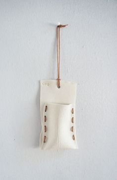 FP w/stitches Flower Pocket White Linen by OVOceramics on Etsy, $24.00