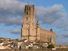 CATHEDRALES DE FRANCE (ALBI, Tarn): Albi cathedral stands like a sentinel above the Tarn.  Site of the Cathar heresy this brick cathedral soars from the landscape.