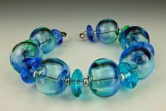 Beautiful hollow lampwork beads by Charmaine Jackson on Etsy.