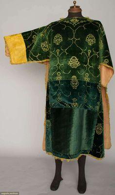 "TEAL VELVET DALMATIC, ITALY, 1400-1424  Go Back        April 17, 2013 - NEW YORK CITY      New York City    Silk velvet cut to stylized floral outline pattern, gold silk damask sleeve ends, Slv-Slv 54"", L 48"", (velvet patched in back) very good."