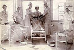 Operating Room of the Guntur Hospital, ca. 1914-1920. L-R: Nurse Rebekah Hoffman, Dr. P. Paru, Dr. Anna S. Kugler, unidentified nurse, Dr. Eleanor B. Wolf, unidentified nurse.