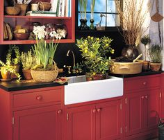 Red kitchen cabinets with black counters and white farmhouse sink - Plain & Fancy Cabinetry